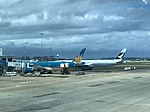 Vietnam airlines and Cathay Pacific Boeing in YSSY.jpg