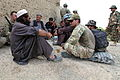 Villagers talk with U.S. soldiers as they have tea outside Forward Operating Base Sharana in the Paktika province of Afghanistan on Aug 120823-A-MR490-016.jpg