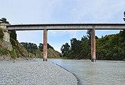 photo of a bridge high above over a river