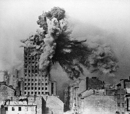 "The Prudential building in Warsaw being hit by 2-ton mortar shell from a Karl-Gerat. The picture was taken by Polish soldier Sylwester Braun ""Kris"" on 28 August 1944. Warsaw Uprising - Prudential Hit - frame 2a.jpg"