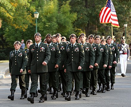 The Ranger Honor Platoon marching in their tan berets and former service uniform Wayne Downing funeral honor guard.jpg