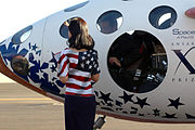 Wife of astronaut Brian Binnie greets him upon compleation of the final flight photo D Ramey Logan