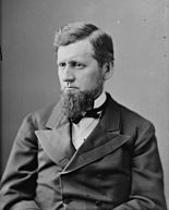 A photograph of a man wearing nineteenth-century formal clothing