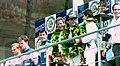 Winners Hurley Haywood, Mauro Baldi & Yannick Dalmas on the podium at the 1994 Le Mans (31933290796).jpg