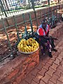 Woman selling bananas in Kampala.jpg
