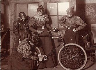 Bicycle mechanic - Repairing a bicycle, c. 1895
