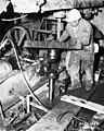 Worker at Boundary Dam, 1965 (48044305212).jpg