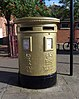 Rower Tom James's golden post box in Wrexham
