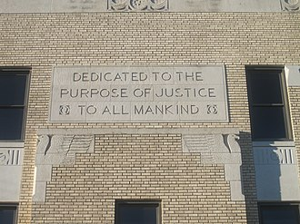 "Ochiltree County, Texas - The Ochiltree County Courthouse contains the inscription on one side, ""Dedicated to the Purpose of Justice to All Mankind."" Click to read."