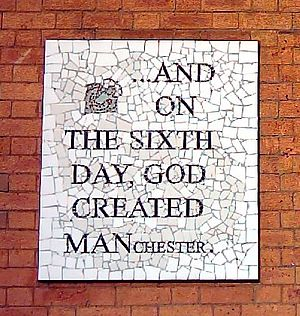 A mosaic in Manchester that says '... And on the sixth day, God created Manchester'
