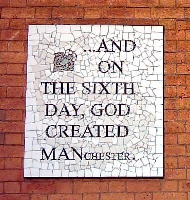alt=A mosaic in Manchester that says '...And on the sixth day, God created Manchester'