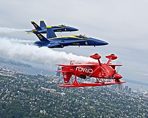 Sean D. Tucker - Sean D. Tucker flying inverted with the US Navy Blue Angels over Seattle