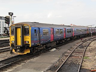 153399 is a hybrid 2-car unit consisting of a class 150 vehicle No. 57221 (nearer camera) and class 153 153369.