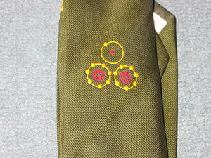 WE.177 - Detail of the official WE.177 project tie.  The WE.177 project was denied a project tie for many years, because the project code was, unusually, itself classified.  The symbols represent atoms: hydrogen, above two atoms of nitrogen; atomic numbers 1, 7, and 7, respectively.