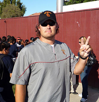"""Brennan Carroll - Carroll making the USC """"V"""" for victory sign after a 2008 fall practice"""