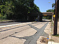 2014-08-27 13 01 18 View west along Parkway Avenue (Mercer County Route 634) near the Delaware and Bound Brook Railroad underpass, with concrete pavement likely dating to the 1950s.JPG