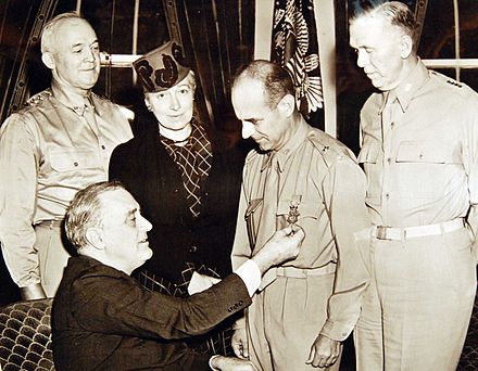 Doolittle received the Medal of Honor in 1942 from President Roosevelt in a ceremony attended by (standing, L-R) Lt. Gen. H.H. Arnold, Josephine Doolittle, and Gen. George C. Marshall. 208-PU-52-LL-12 (34371208606).jpg