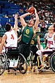 221000 - Wheelchair basketball Brad Ness shoots - 3b - 2000 Sydney match photo.jpg