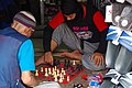 2 guys playing chess.jpg