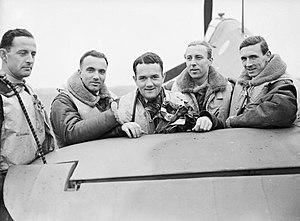 "John A. Kent - (Left to right) Pilot Officer Mirosław Ferić, Flying Officers Bogdan Grzeszczak, Jan Zumbach and Zdzisław Henneberg and Flight-Lieutenant J. A. Kent, who commanded ""A"" Flight of No. 303 (Polish) Squadron RAF, October 1940."