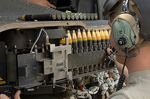 30 mm caliber - 30×113mm rounds being loaded into an AH-64D Apache Longbow