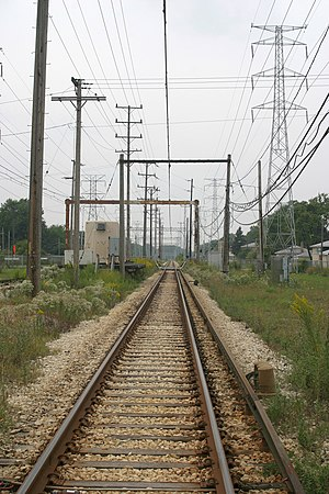 Yellow Line (CTA) - Prior to 2004, the section of the line west of the East Prairie Road grade crossing was electrified with overhead catenary instead of third rail.