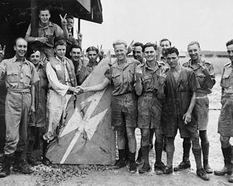 No. 488 Squadron RNZAF - Buffalo pilots of No. 488 Squadron RNZAF based at Kallang display the tail fin of a Japanese Ki-46 aircraft of 81st Sentai which they shot down over Johore, Malaya, January 1942.