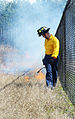 A Naval Submarine Base Kings Bay firefighter sets a prescribed burn..jpg