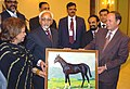 A Turkmen artist presenting a painting to the Vice President, Mohammad Hamid Ansari at a reception hosted by the Ambassador of India, Mohammad Afzal at Ashgabat in Turkmenistan on April 04, 2008.jpg