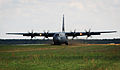 A U.S. Air Force C-130J Super Hercules aircraft lands on an unimproved runway at Powidz Air Base, Poland, Aug. 25, 2014, during a mission as part of the Poland Off-station Training Deployment, a 2-month Air 140825-F-UE958-034.jpg