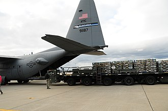 328th Airlift Squadron - A squadron C-130 Hercules is loaded with water to support Hurricane Sandy relief efforts