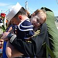A U.S. Sailor assigned to the aircraft carrier USS John C. Stennis (CVN 74) hugs his wife and child during a homecoming ceremony at Naval Station Kitsap in Bremerton, Wash., May 3, 2013 130503-N-KD696-202.jpg