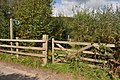 A gate into a fenced off corner of a field exited by a stile - geograph.org.uk - 2082334.jpg