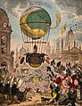 A large balloon flies over a town crowded with people. Colou Wellcome V0040883.jpg