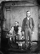 A man, woman and two girls NLW3364771.jpg