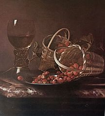 Strawberries and red currants with a roemer on a marble ledge