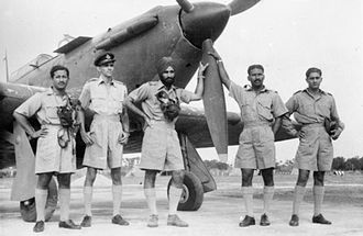Arjan Singh - Arjan Singh as a flight lieutenant with a group Indian pilots from No.1 Squadron standing by a Hawker Hurricane IIc. L to R : Ibrahim, Homi Ratnagar, Arjan Singh, Henry and Murcot. World War II.