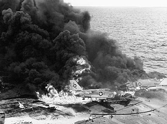 January 14: Explosion kills 27 on USS Enterprise Aircraft burning on USS Enterprise (CVN-65).jpg