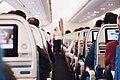 Airplane aisle during flight (Unsplash).jpg