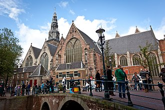 The Oude Kerk was consecrated in 1306 CE. Amsterdam (6578772447).jpg