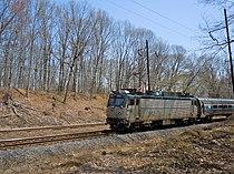 Amtrak 942 pushing a Keystone Service train through Duffy's Cut, April 2011.jpg