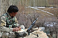 An Afghan Local Police (ALP) officer eats a meal at Siya Boghal village in Khas Uruzgan district at Uruzgan province, Afghanistan, March 16, 2013 130316-A-PS372-082.jpg