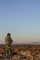 An Afghan National Army commando with the 1st Tolai, 3rd Special Operations Kandak scans the horizon during a clearing operation in the Shah Wali Kot district of Kandahar province, Afghanistan, Nov. 11, 2013 131111-A-XP635-071.jpg