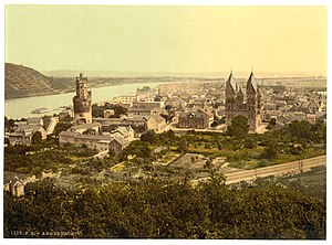 "Andernach - Andernach in 1900 with ""Round Tower"" and ""St. Mary Assumption Church""; the Rhine river is visible in the background; in the foreground the new railway tracks"