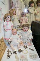 Antique baby dolls (26420299183).jpg
