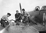 Armourers replenish the ammunition in a Hawker Hurricane Mk I of No. 310 (Czechoslovak) Squadron RAF at Duxford, Cambridgeshire, 7 September 1940. CH1297.jpg