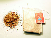 A teabag containing artichoke tea (right) and ...
