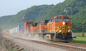 A BNSF Railway intermodal train passes some maintenance of way equipment on the double track mainline in Prairie du Chien, Wisconsin.