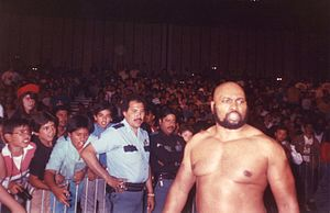 "Allen Coage - Coage approaching the ring as ""Bad News Brown""."