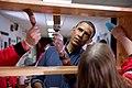 Barack Obama staining shelves.jpg
